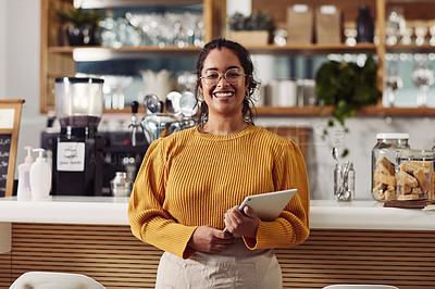 Buy stock photo Shot of a woman using a digital tablet while working in a cafe