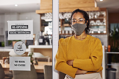 Buy stock photo Shot of a cafe owner re-opening after lockdown