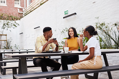 Buy stock photo Shot of a group of young businesspeople having a meeting outside of an office