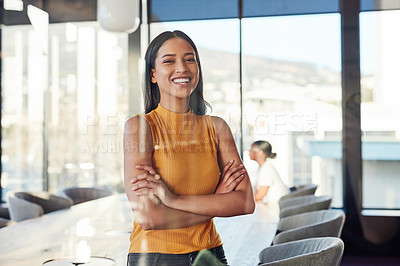 Buy stock photo Portrait of a confident young businesswoman in the boardroom of a modern office with her colleagues in the background