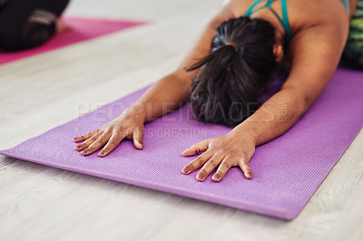 Buy stock photo Shot of a young woman practicing the child's pose during a yoga session
