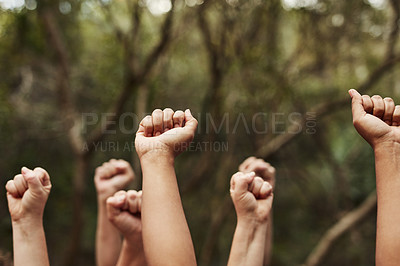 Buy stock photo Cropped shot of a group of unrecognisable people raising their hands in solidarity out in nature