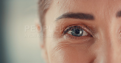 Buy stock photo Portrait of a young woman's eyes expressing happiness