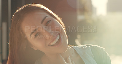 Buy stock photo Portrait of a beautiful young woman standing outside on a balcony