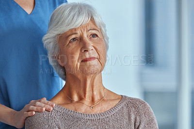 Buy stock photo Shot of a nurse consoling a senior patient in a nursing home