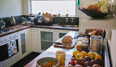 Buy stock photo Shot of the interior of a kitchen at home during lunch time