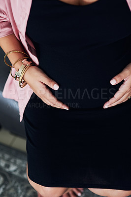 Buy stock photo Closeup shot of a pregnant woman holding her stomach