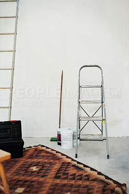 Buy stock photo Shot of paint and a ladder in an empty home that's being renovated