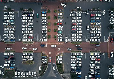 Buy stock photo High angle shot of a large parking lot in an urban city