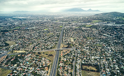 Buy stock photo High angle shot of roads and freeways in and around an urban city