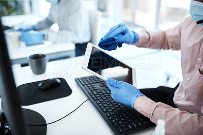 Buy stock photo Closeup shot of an unrecognisable businessman cleaning a digital tablet in an office