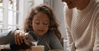 Buy stock photo Cropped shot of a little girl and her mother making hot chocolate home