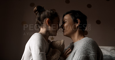 Buy stock photo Cropped shot of a woman and her young daughter bonding in the bedroom at home