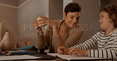 Buy stock photo Shot of a mother helping her little daughter with her homework