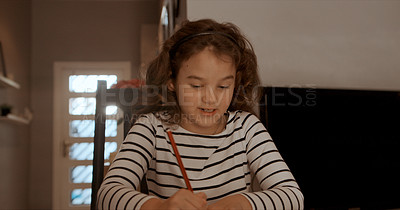 Buy stock photo Shot of a little girl writing in a book at home
