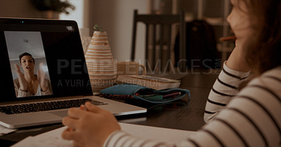 Buy stock photo Shot of a little girl having a video call with her teacher on a laptop at home