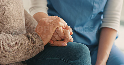 Buy stock photo Cropped shot of a nurse and senior woman holding hands