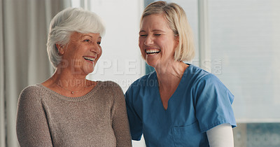Buy stock photo Shot of a senior woman chatting with a nurse at an old age home