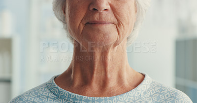 Buy stock photo Shot of a senior woman wearing a hospital gown in a hospital