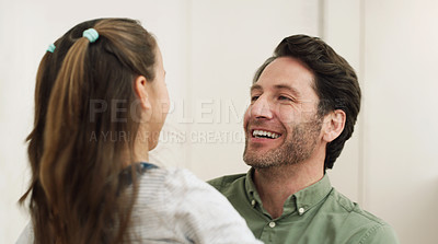 Buy stock photo Cropped shot of a little girl and her father at home