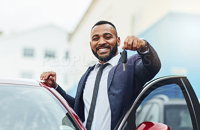 Buy stock photo Shot of a well-dressed man holding the keys to his new car