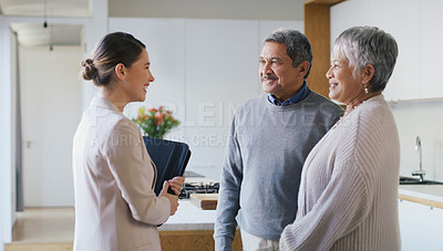 Buy stock photo Shot of a senior couple meeting with a consultant to discuss finances at home