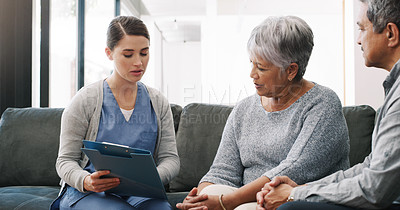 Buy stock photo Shot of a senior couple having a consultation with a doctor at home