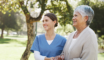 Buy stock photo Shot of a senior woman going for a walk in the park with her nurse