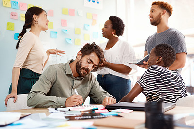 Buy stock photo Shot of a group of young creatives working together in an office