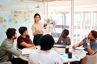 Buy stock photo Shot of a group of young creatives having a meeting in an office