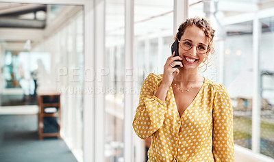 Buy stock photo Cropped shot of an attractive young female designer making a phonecall while standing in her office