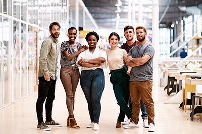 Buy stock photo Portrait of a group of young creatives standing together in an office