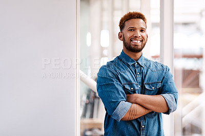 Buy stock photo Cropped portrait of a handsome young male designer standing with his arms folded in the office