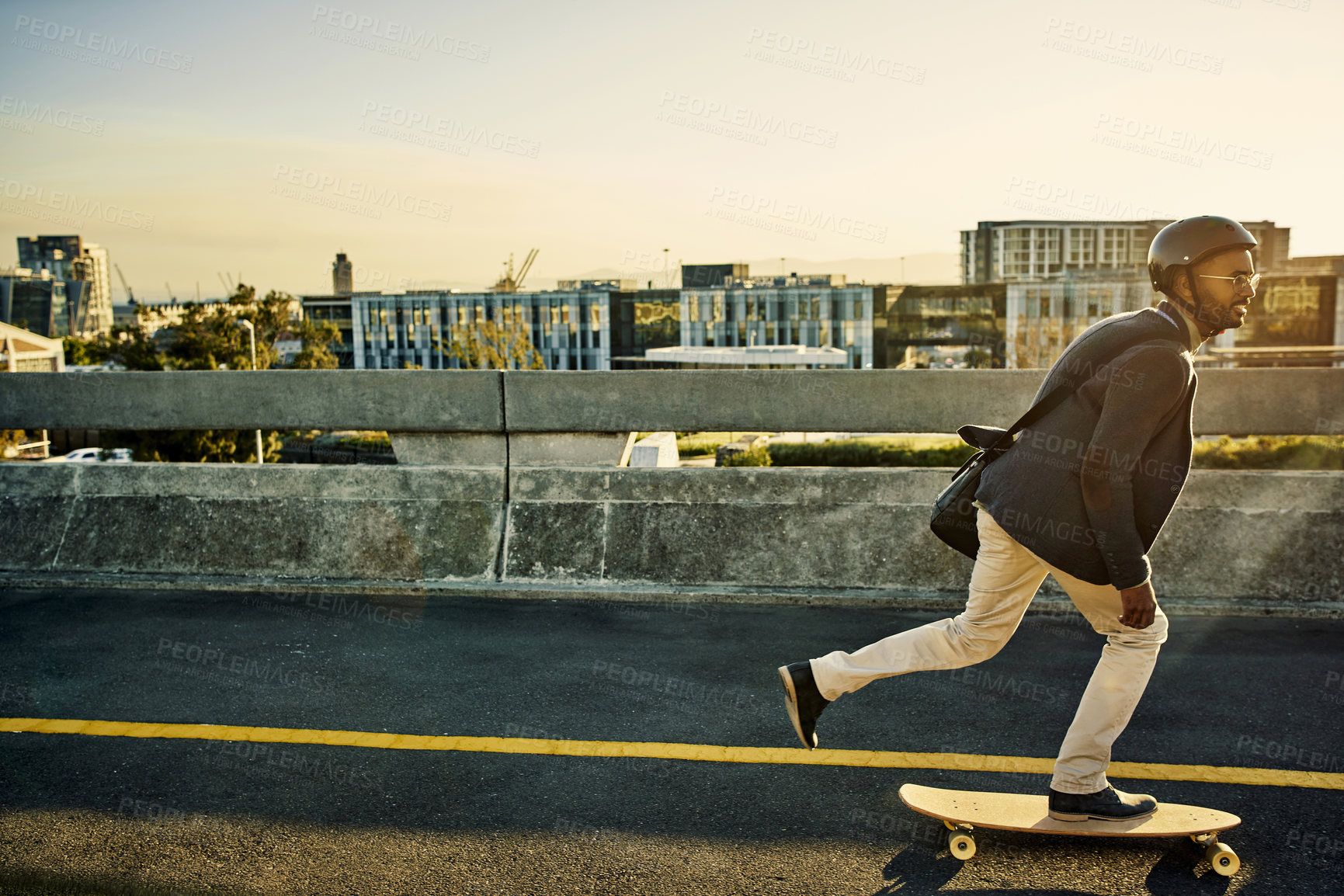 Buy stock photo Full length shot of a handsome young businessman travelling to work on his skateboard