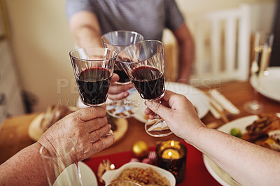 Buy stock photo Cropped shot of a group of unrecognisable people toasting with wine at Christmas lunch