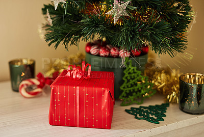 Buy stock photo Shot of a present under the Christmas tree at home