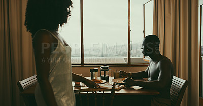 Buy stock photo Shot of a couple having breakfast together at home