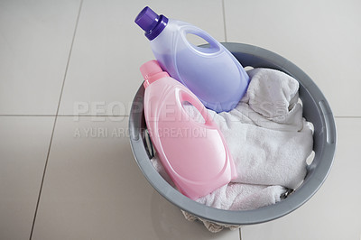 Buy stock photo High angle shot of a washing basket filled with clean laundry and two bottles of fabric softener