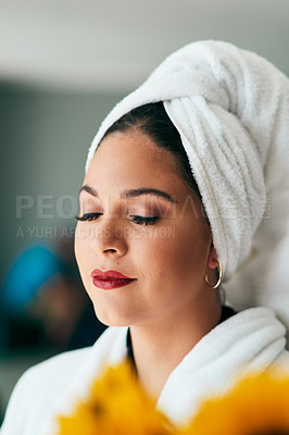 Buy stock photo Shot of a beautiful young woman spending a quiet moment alone while going through her beauty routine