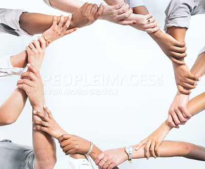 Buy stock photo Closeup shot of a group of unrecognisable businesspeople forming a circle with their hands