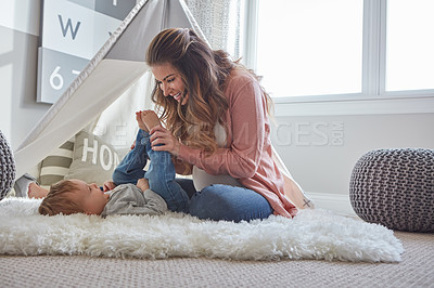 Buy stock photo Shot of a pregnant woman bonding with her toddler son at home