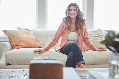Buy stock photo Shot of a beautiful young woman relaxing on a sofa at home