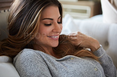 Buy stock photo Shot of a beautiful young woman spending a relaxing morning at home