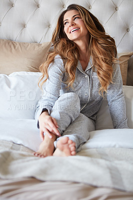 Buy stock photo Shot of a beautiful young woman waking up in bed feeling refreshed