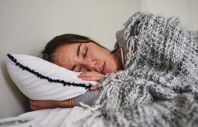 Buy stock photo Cropped shot of a woman sleeping peacefully in her bed