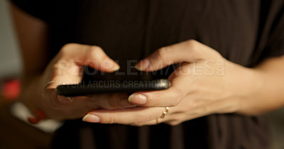 Buy stock photo Shot of an unrecognisable woman using a smartphone at home