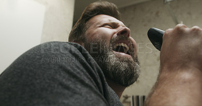 Buy stock photo Cropped shot of a mature man lip synching while going through his morning routine