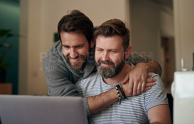 Buy stock photo Shot of a mature couple embracing while using a laptop together at home