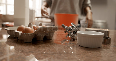 Buy stock photo Cropped shot of a woman baking at home