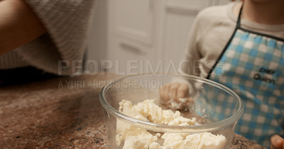Buy stock photo Cropped shot of little girl assisting her mother while baking